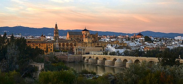 Córdoba, with the Roman bridge in the foreground, and the mountains in the distance.